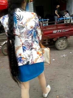 Liu Chun went street with wrapped long braid
