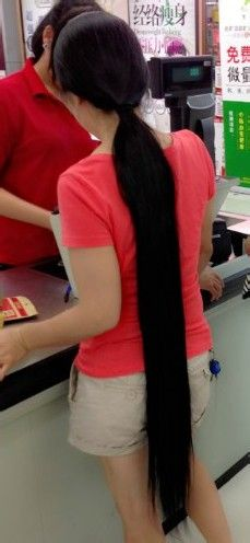 She is not young girl but has super long ponytail