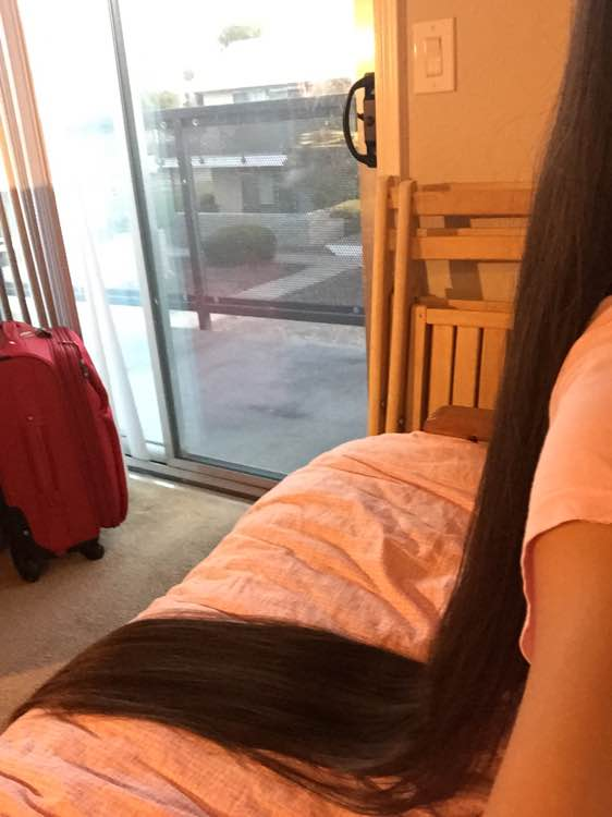 Very long hair lie on bed