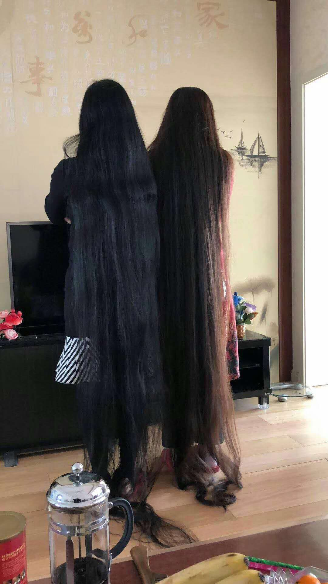 2 super long hair ladies stand together