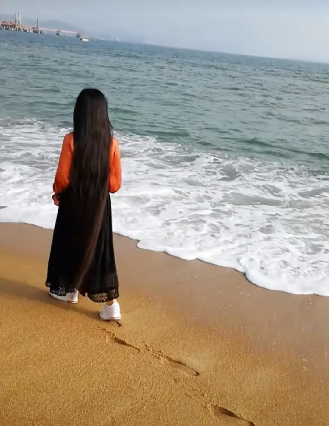 Super long hair on seashore and snow land