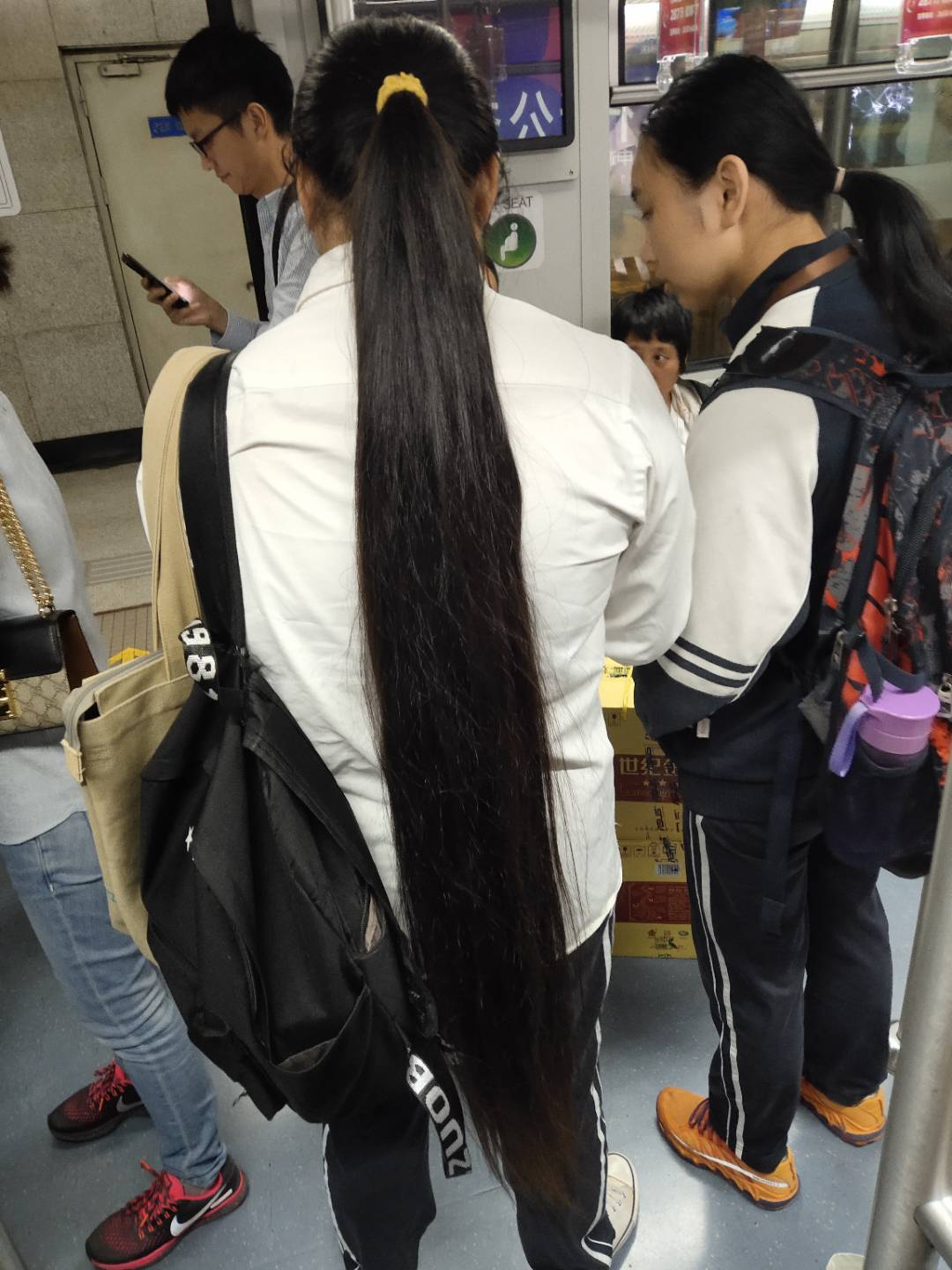 Streetshot of super long ponytail in subway